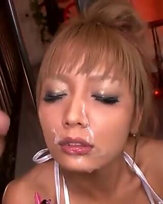 Hot Japanese cutie frantically sucks on three delicious peppers.
